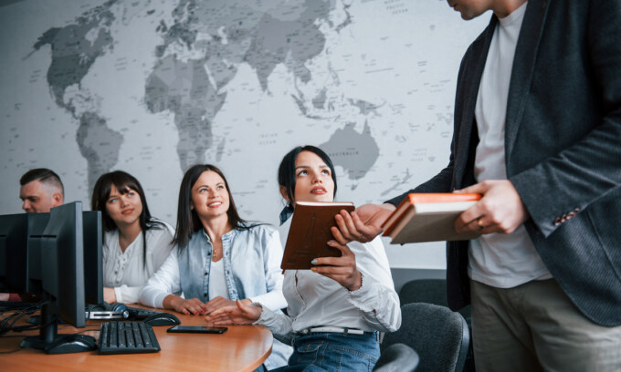 You better write it. Group of people at business conference in modern classroom at daytime