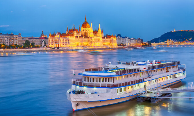 Travel and european tourism concept. Parliament and riverside in Budapest Hungary with during blue hour sunset